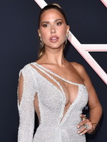 Kara Del Toro braless in a low-cut bareback high-slit shiny dress at the Charlie's Angels premiere in LA