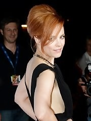 Rachel McAdams braless shows big cleavage in hot black mini dress at About Time premiere in Munich