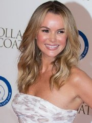 Amanda Holden busty and leggy in white strapless high slit dress at Battersea Dog's Collars & Coats Gala Ball in London