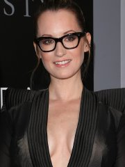 Ingrid Michaelson braless showing huge cleavage and legs in revealing black dress at The Space Between Us premiere in LA