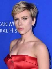 Scarlett Johansson busty in red strapless gown for American Museum Of Natural History's Gala