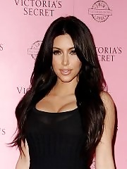 Kim Kardashian leggy & busty wearing little black dress at VS 2011 swimwear collection launch in LA