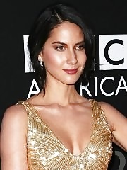 Olivia Munn cleavy wearing a tight golden dress at 2012 BAFTA Los Angeles Britannia Awards