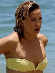 Kate Hudson looks hot in tiny yellow strapless bikini at the beach in Hawaii