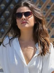 Danielle Campbell looks hot in a white sheer shirt and denim shorts out in Venice