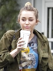 Miley Cyrus leggy wearing stockings & biker boots outside Starbucks in Hollywood