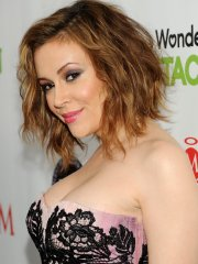 Busty Alyssa Milano wearing a strapless dress at the Maxim Big Game Weekend in NYC