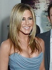 Jennifer Aniston showing big cleavage in blue tube dress at the Life Of Crime premiere at 2013 TIFF