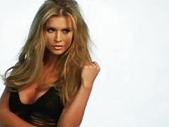 Joanna Krupa sizzles sexily in the rain as she models her near-naked body