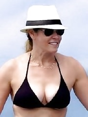 Chelsea Handler showing off her big bikini boobs while paddleboarding in Hawaii