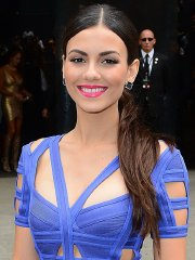 Victoria Justice showing big cleavage legs and ass braless in tight blue mini dress at the Herve Leger Fashion Show