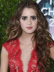 Laura Marano cleavy and leggy in a tiny red romper at the Teen Choice Awards 2016 in Inglewood