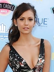 Nina Dobrev braless flaunting her big boobs in a low cut colorful outfit at 2013 Teen Choice awards