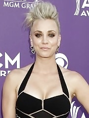 Kaley Cuoco shows cleavage wearing a low cut black dress at Academy of Country Music Awards