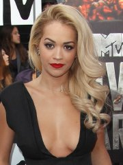 Rita Ora braless showing huge cleavage in black maxi dress at MTV Movie Awards in LA