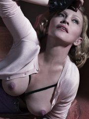 Madonna showing off her boobs in the Mert Alas and Marcus Piggott photoshoot for the January 2015 issue of Interview