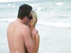 Paris Hilton doing what she does best: skanking up and making out at the beach