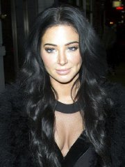 Tulisa Contostavlos showing cleavage outside the Ramusake club in London