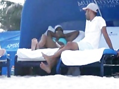Halle Berry relaxing at the beach in a sexy blue bikini that shows off her big tits