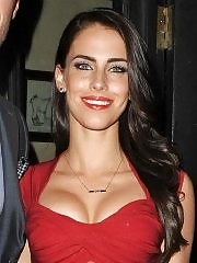 Busty Jessica Lowndes wearing a low cut red dress at the Aston Martin event in London