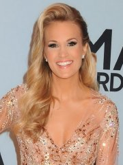 Carrie Underwood cleavy and leggy in sexy see-thru dresses at 47th Annual CMA Awards in Nashville