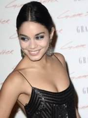 Vanessa Hudgens braless wearing a low cut maxi dress at 'Gimme Shelter' premiere in Paris