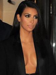 Kim Kardashian braless wears wide open jacket and mini skirt at the Lanvin SS 2015 Fashion Show in Paris