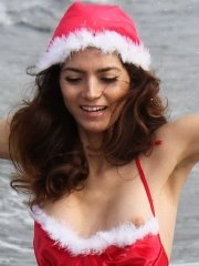 Blanca Blanco nipple-slip in a red thong Christmas themed lingerie at the beach in Malibu