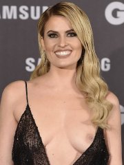Adriana Abenia boob-slip in black sheer gown at the GQ Men of the Year Awards in Madrid