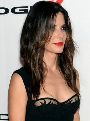 Sandra Bullock braless wearing a low cut black dress at the 17th annual Hollywood Film Awards in LA