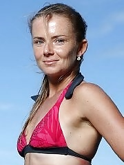 Daniela Hantuchova in bikini surfing on a beach in Brisbane, Australia