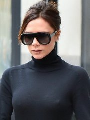 Victoria Beckham see-through to bra and nipple-pokies out in NYC
