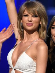 Taylor Swift shows off her ass and huge cleavage wearing a white jumpsuit at the 2015 Billboard Music Awards in Vegas