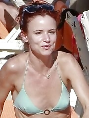 Juliette Lewis showing her smal tits and as in skimpy light blue bikini at the beach in Mexico