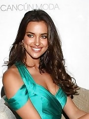 Irina Shayk leggy wearing high slit turquoise dress at the Cancun Moda Nextel event in Mexico