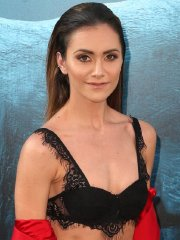 Alyson Stoner busty in black lace bra & wide open red pantsuit at The Meg premiere in Hollywood