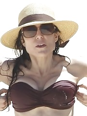 Bethenny Frankel showing off her hot body in a brown tube bikini at the beach in Sydney