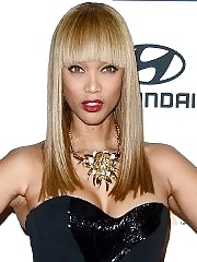 Tyra Banks showing cleavage at Clive Davis & The Recording Academy's 2013 Pre-GRAMMY Gala