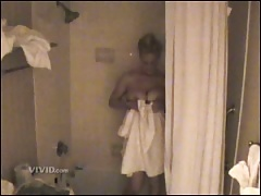 Mindy McCready's sex tape footage of her in the shower showing her nice tits and her ass and then getting fucked on a bed in a hotel room