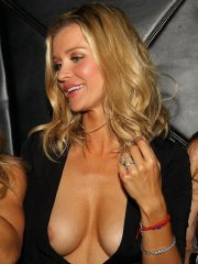 Joanna Krupa hot nipple-slip boob-show and panty-peek in sexy black dress at Mynt Lounge