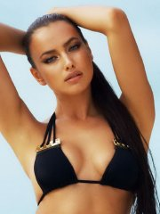 Irina Shayk showing off her curvy body at the Beach Bunny 2014 bikini photoshoot