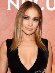 Jennifer Lopez busty in a plunging high-slit dress for NBCUniversal Summer Press Day