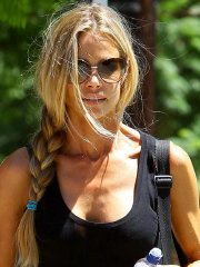 Denise Richards wearing a tenk top and a denim shorts out at Coldwater Park in Beverly Hills