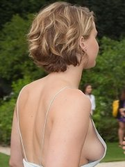 Jennifer Lawrence braless flashing bare side-boob at Christian Dior Fashion Show in Paris